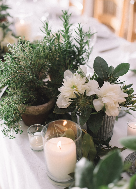Aromatic herbs and white flowers table setting